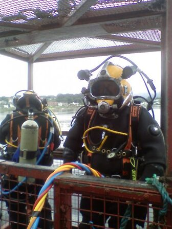 Commercial Diving Contractors Providing Diving Services From Man Riding Basket For Underwater Services